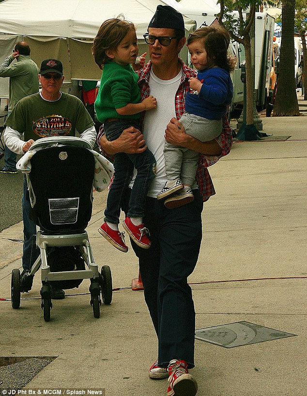 Daddy on duty: Johnny Knoxville headed to a Los Angeles farmers market with toddlers Rocko, three, and Arlo, 18 months
