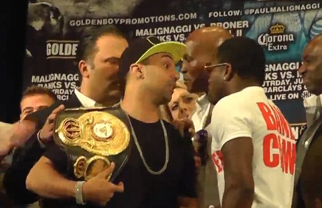 Heated: Paulie Malignaggi (left) and Adrien Broner face off ahead of their world title clash next month