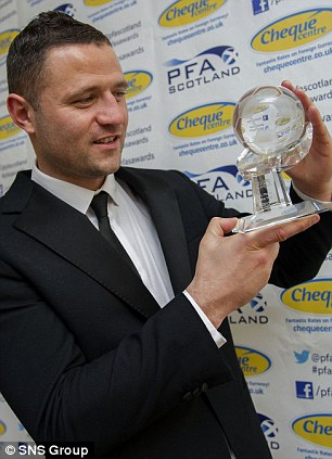 Motherwell's Michael Higdon takes a good look at his PFA Scotland Player of the Year award