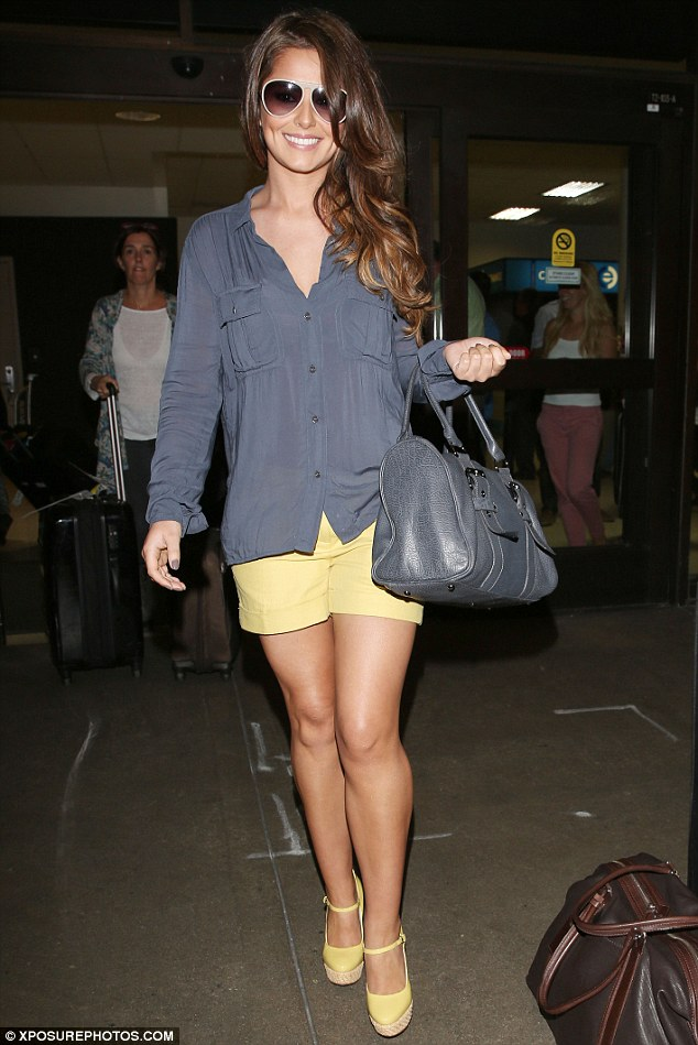 Mellow yellow: Cheryl Cole positively dazzled as she touched down at Los Angeles' LAX Airport on Saturday evening