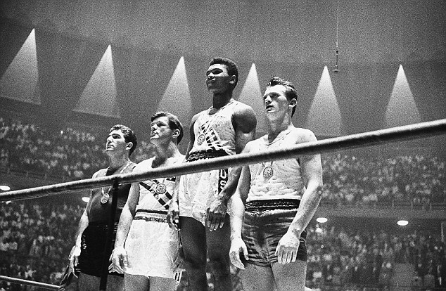 Olympian: Ali, then Cassius Clay, competed at the Rome Olympics and a signed torch will go under the hammer