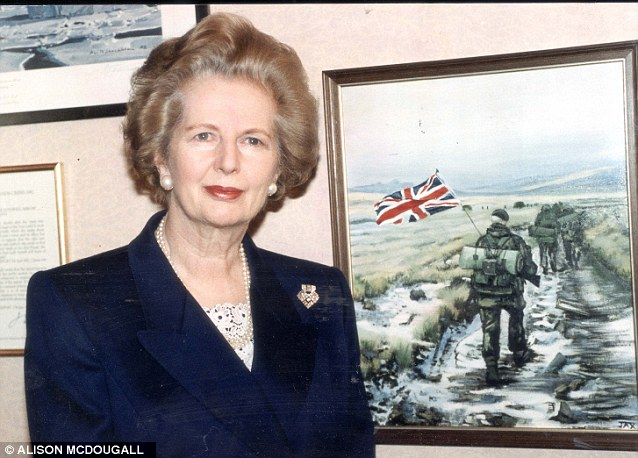 Auction: The telex sent to Prime Minister Margaret Thatcher to confirm the end of the Falkland's War is to go under the hammer. Mrs Thatcher is seen here in Whitehall, beside a famous image of British troops during the conflict