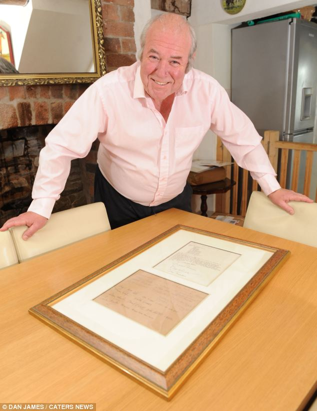 Historic: Richard Westwood-Brookes historic books specialist at Mullocks Auctioneers stands over the Falklands Telex