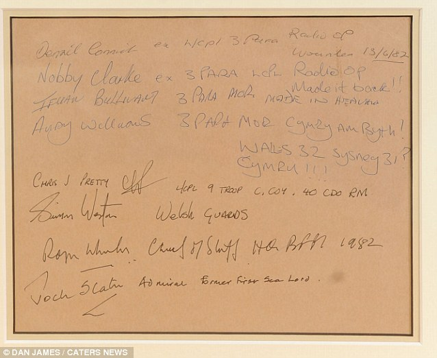 Names: Another sheet of paper framed alongside the telex is signed by a number of Falkland's servicemen, including the injured Welsh Guard Simon Weston