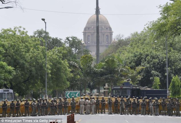 Police in New Delhi line up outside Parliament before a protest. Outraged people have taken to the streets to protest against the increasing numbers of sex crimes against women in the country