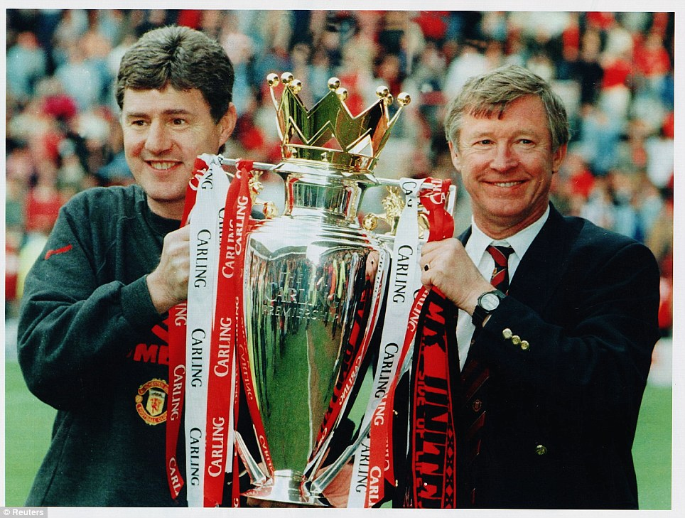 1995-1996: Sir Alex Ferguson lifts his third Premier League trophy in 1996 with assistant Brian Kidd