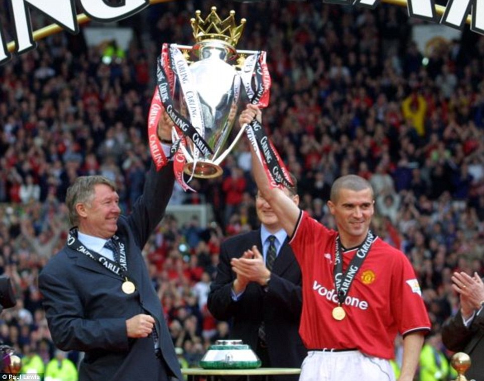 2000-2001: Ferguson and Roy Keane lift the trophy
