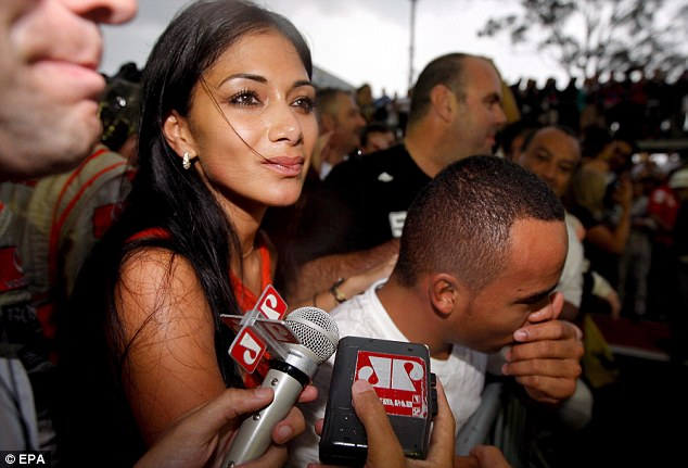 Proud moment: Nick Hamilton (right) and Nicole Scherzinger were moved after his triumph at the Brazilian race