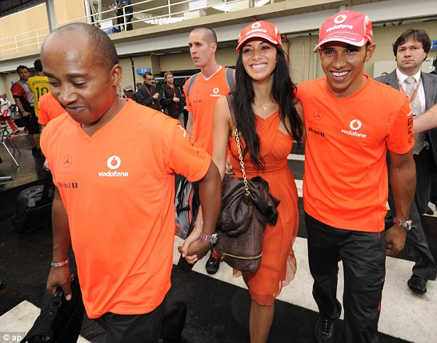 Job done: Hamilton (right) celebrated winning the 2008 world championship with his girlfriend Nicole Scherzinger
