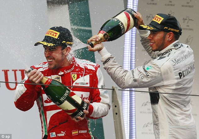 Growing up: Hamilton admires former team-mate Fernando Alonso (left) for his 'sheer speed'