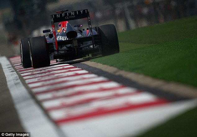 On the edge: Vettel will sometimes run his car over the kerb, which has gone unpunished in the past