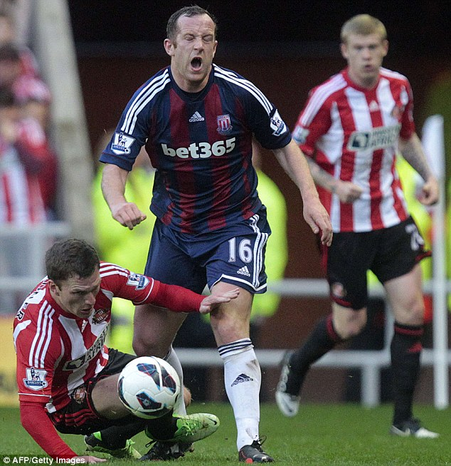 Agony: Craig Gardner was sent off for a poor challenge on Charlie Adam