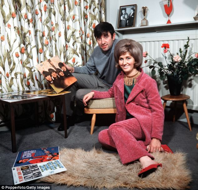 Jimmy Tarbuck pictured at home in Liverpool with his wife Pauline in 1965 holding the Beatles For Sale album. Tarbuck was a school friend of legendary Beatles member John Lennon
