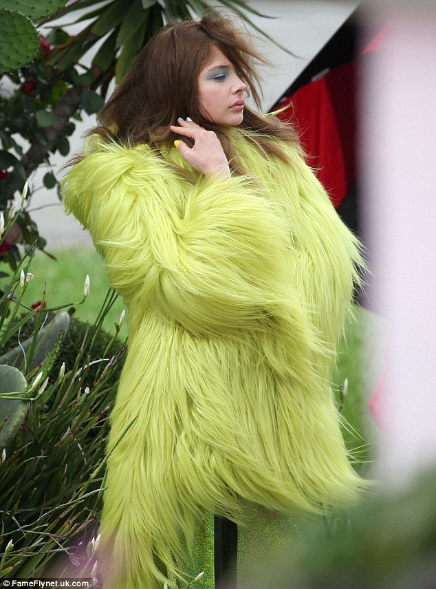 From Carrie to beastly: Chloe Moretz donned a furry jacket that made her look like a character out of Monsters, Inc. for a photo shoot in Los Angeles, on Sunday