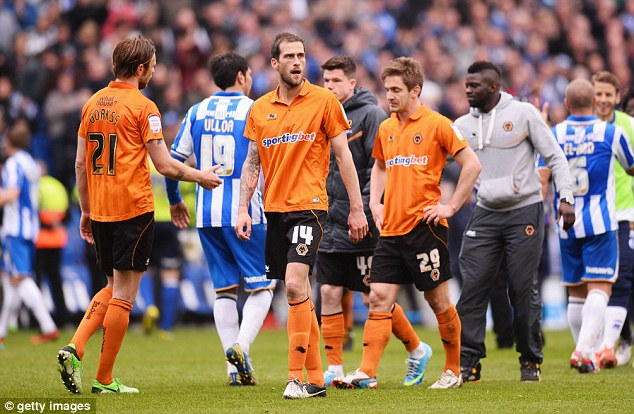 Thanks, but no thanks: Wolves fans refused to take Roger Johnson's shirt after defeat at Brighton