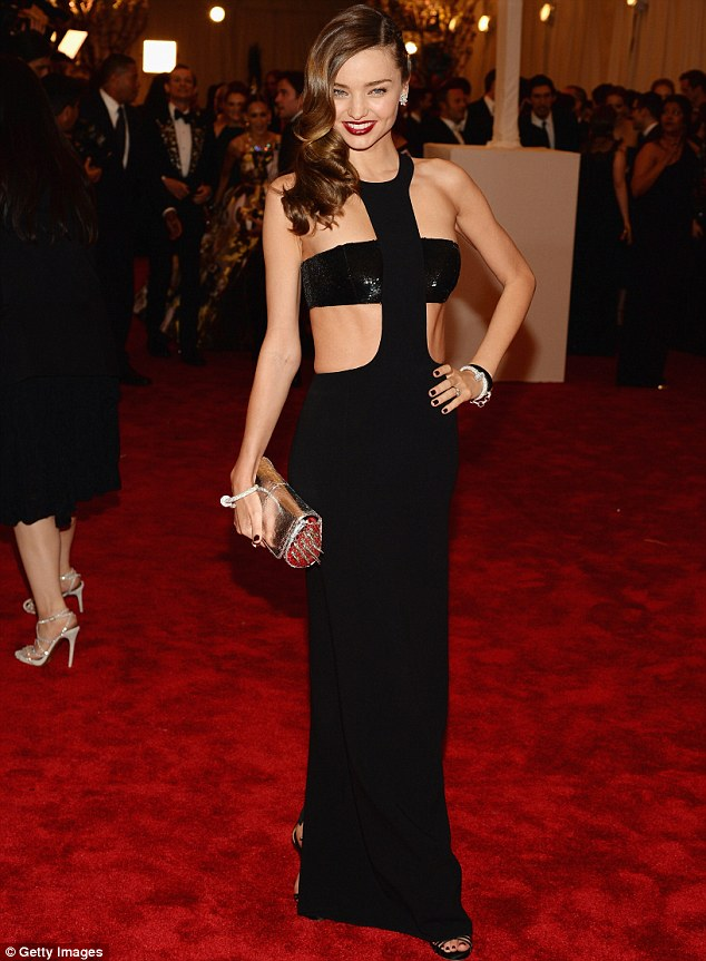 Dressed to impress: MIranda Kerr shows off her stunning figure and toned abdominal muscles in a sleek black dress at Monday night's Met Balll