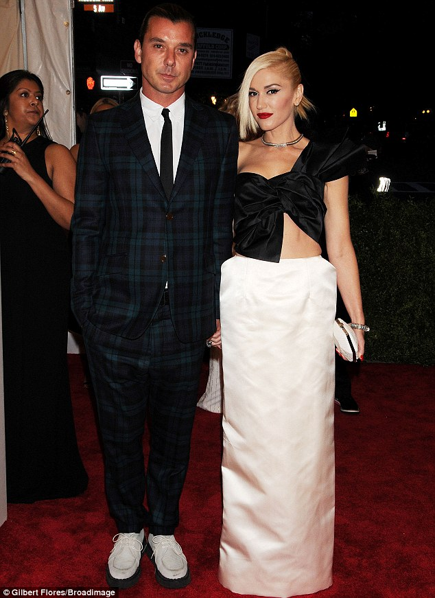 Glammed up couple: Gwen arrived with husband Gavin Rossdale who wore a blue tartan suit in homage to the punk theme