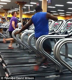 Tired of running: Youtube user David Wilson posted the video online with comment, 'I see this guy dancing almost every day on the treadmill. Had to share. Enjoy!'