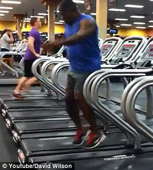 Dance workout: A video uploaded to YouTube shows a man at a gym - apparently unaware that he is being filmed - spinning and twirling on a treadmill