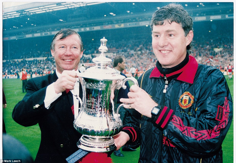 1994: Ferguson parades the FA Cup with assistant Brian Kidd after beating Chelsea 4-0 at Wembley