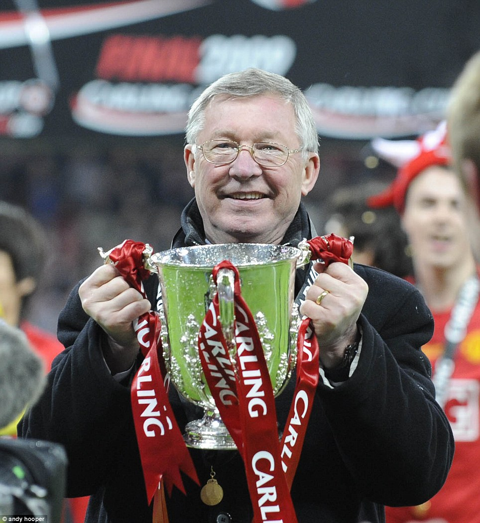 2009: Ferguson with the Carling Cup trophy after United beat Tottenham on penalties
