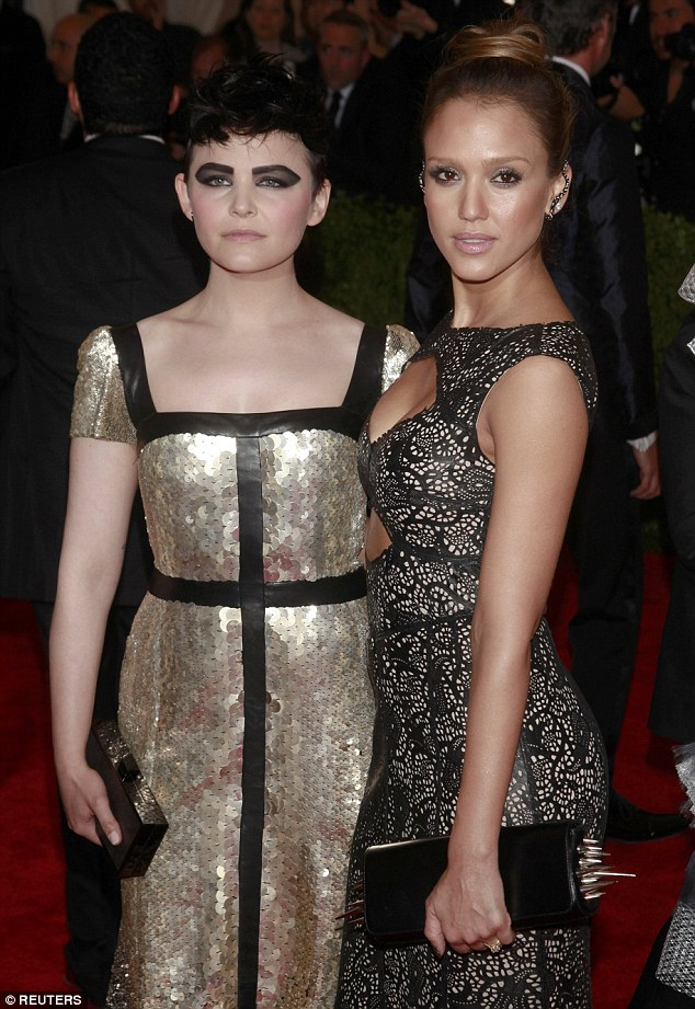 Be careful! Jessica posed close to Ginnifer as she held onto her heavily spiked clutch