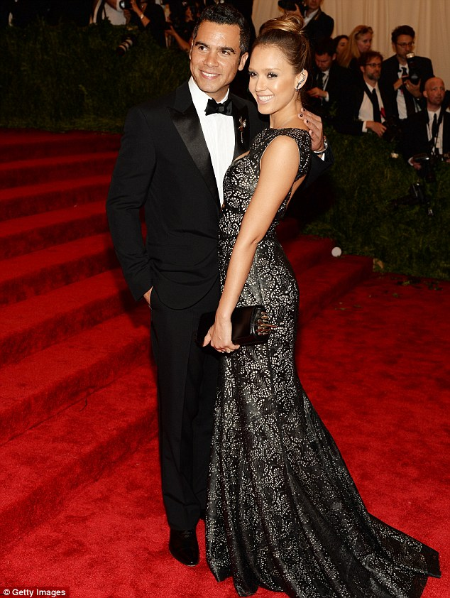 Glamorous couple: Jessica posed with her husband Cash Warren on the carpet