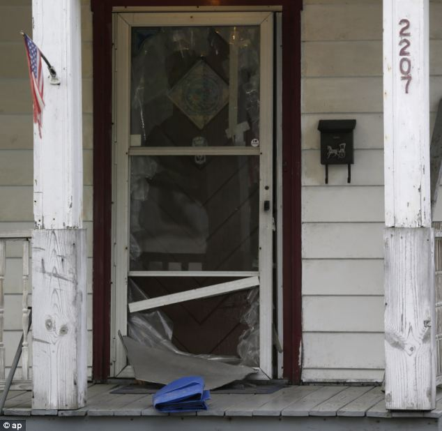 Escape route: The front door of a house where the women escaped after a neighbor helped them