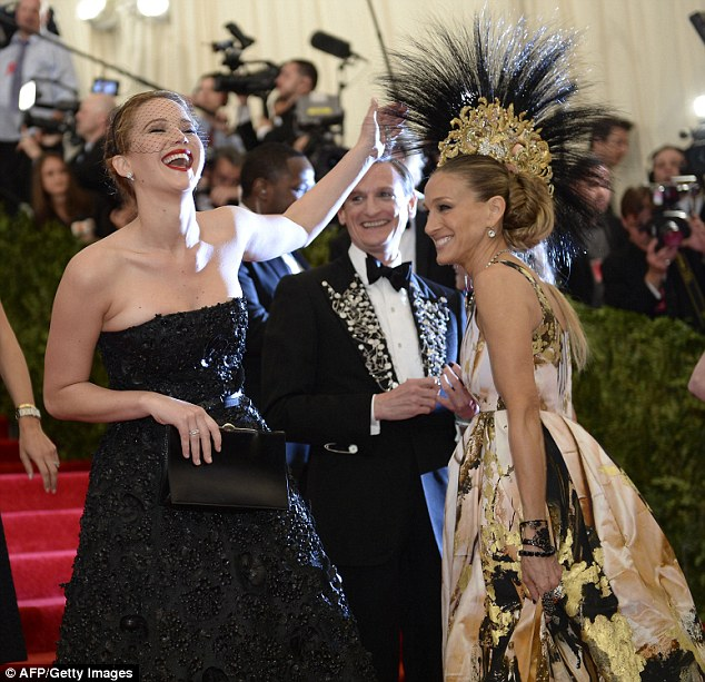 Props: The dimunitive funnywoman bumped into Oscar winner Jennifer Lawrence on the red carpet and allowed the Oscar winner to stroke her hat