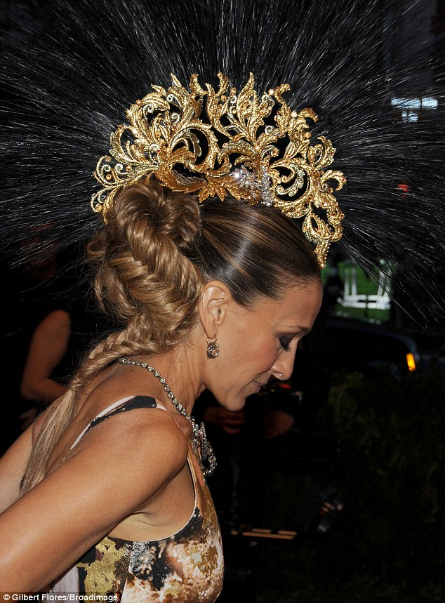 Filigree: The Philip Treacy gold headpiece featured a black Mohawk-style brush on top