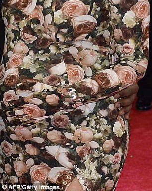 In full bloom: Pregnant Kim Kardashian sports a distinctive floral gown complete with unflattering split and matching glove and heels