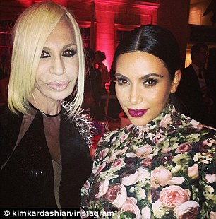 Rubbing shoulders: Kim posted photographs of herself posing with designers Donatella Versace and Valentino