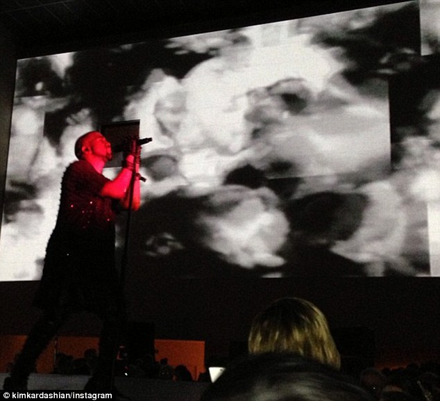 Kim tweeted a picture of Kanye performing which she captioned 'Baby you're AWESOME'