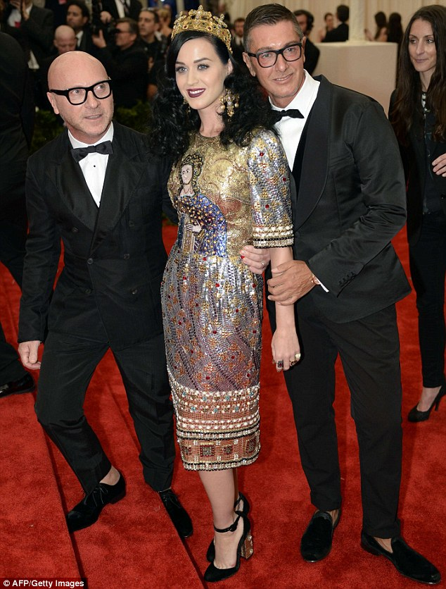 Her dates: The singer stood between Domenico Dolce (left) and Stefano Gabbana (right), the men who designed her mosaic dress