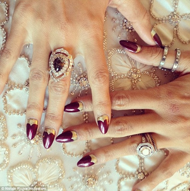 Talons: The former BFF of Paris Hilton also rocked a golden-tipped manicure courtesy of nail artist Kimmie Kyees