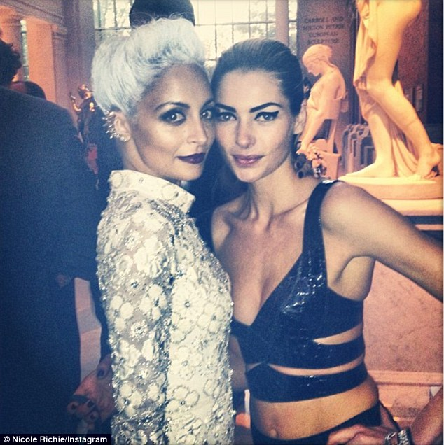 Punk attitude: The 31-year-old reality star, seen here with Aussie model Jessica Hart, has always coasted through her career thanks to her refreshingly ballsy personality