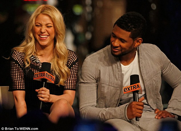 Giggles: The singer-songwriter seemed to be in high spirits as she chatted away alongside Usher