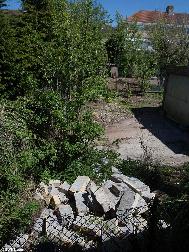 Tragic: These concrete blocks are pictured in the back garden of the family home. Despite paramedics carrying out emergency life-saving work, the Surranna died shortly after arrival at hospital