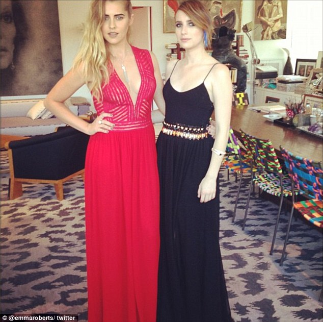 Time to party: Emma posed with pal Teresa Palma, who dazzled in a floor-length red gown