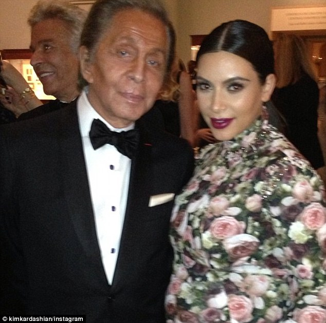 Trying to get a freebie? Kim took a photo of herself with fashion designer Valentino, writing 'living legend'