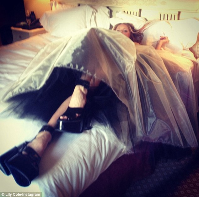 Exhausted: Lily Cole posted a picture of herself collapsing on her bed after a night of partying