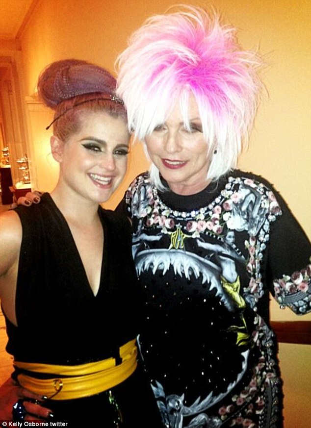Backsage: Kelly grinned as she posed with music icon Debbie Harry, who later performed at the Punk-themed party