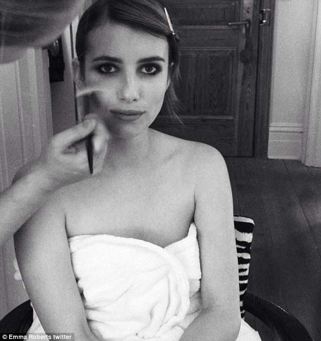 Light dusting: Emma Roberts took a photo of herself as a make-up artist applied the last touches to her face