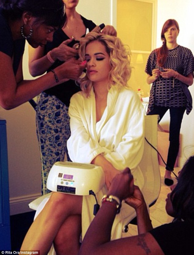 Intimate insight: Rita Ora got someone to take a picture of her as a team of stylists got to work ahead of the event