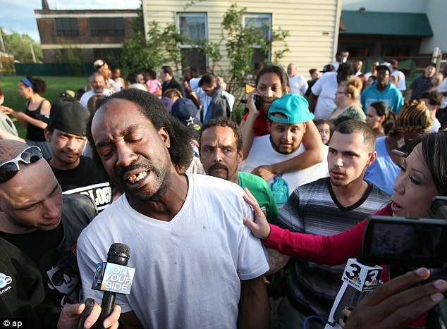 Discovery: Neighbor Charles Ramsey speaks to media after helping Amanda Berry escape the home on Monday