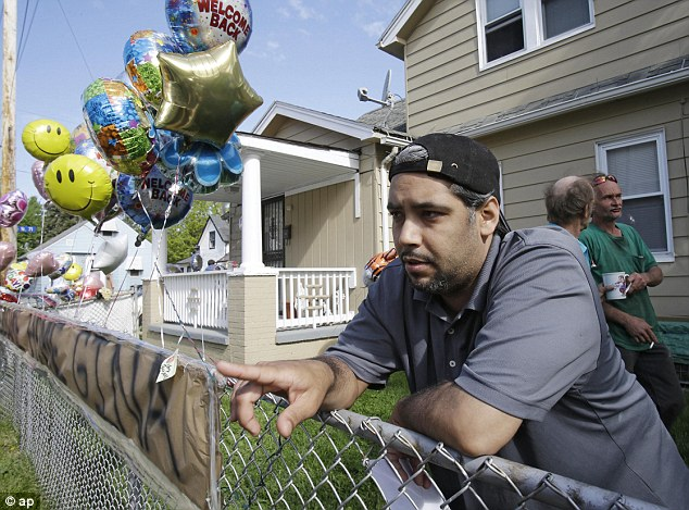 Family: Ricardo DeJesus, outside his family's home, speaks about his relief at the discovery of his sister Gina