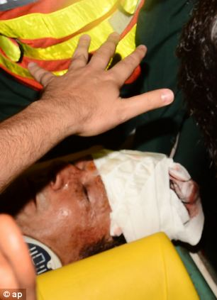 Rescue workers rush Imran Khan to hospital in Lahore, Pakistan, today