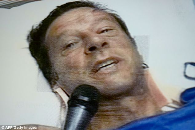 Injured Pakistani politician and former cricketer Imran Khan pictured speaking on state television in a hospital in Lahore  after he fell off a lift taking him to the stage for an election rally