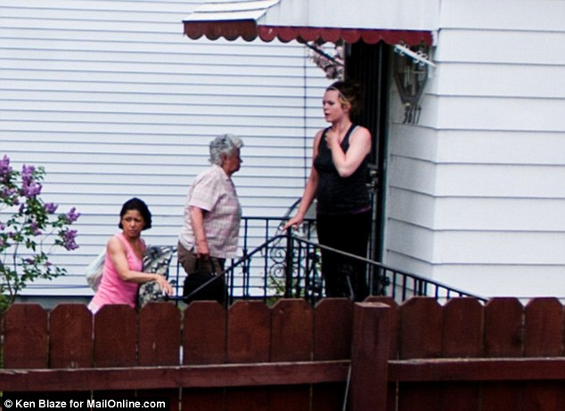 Mother: Lillian Rodriguez (pictured center), the mother of the Castro brothers, returns to her home in Cleveland, Ohio after being questioned by police on Tuesday