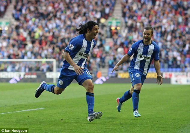 Ahead: Roger Espinoza smashed home at the near post to give Wigan the lead just before half-time